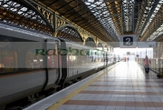 enterprise-northern-ireland-railways-train-parked-at-platform-2-at-Connolly-iarnrod-eireann-station-in-Dublin-with-rail-worker-on-platform