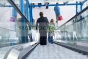 young-woman-in-pinstripe-business-suit-goes-down-escalator-at-connolly-station-dublin