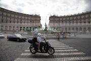 motor-scooter-with-rider-pillion-passenger-crosses-pedestrian-crossing-on-Piazza-Della-Republica-Rome-Lazio-Italy