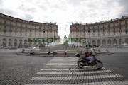 motor-scooter-with-rider-crosses-pedestrian-crossing-on-Piazza-Della-Republica-Rome-Lazio-Italy