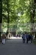 vertical-people-walking-along-the-footpath-through-the-planty-public-parks-gardens-in-Krakow