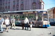 new-completely-painted-decorated-electric-public-transport-tram-travels-past-pedestrians-in-the-old-town-krakow