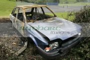 Vandalised,-burnt-out-Ford-Escort,-County-Down,-Northern-ireland.