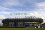 Murrayfield-Rugby-sports-stadium-with-green-grass-blue-cloudy-sky,-Edinburgh,-Scotland,-UK