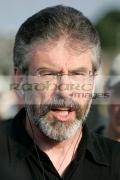 Sinn-Fein-president-MP-MLA-Gerry-Adams-with-mobile-headphones-on-crumlin-road-at-ardoyne-shops