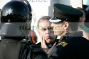 Fr-Aidan-troy-talks-to-PSNI-officers-on-crumlin-road-at-ardoyne-shops-belfast-12th-July