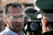 Sinn-Fein-MLA-Gerry-Kelly-talks-to-PSNI-police-officer-on-crumlin-road-at-ardoyne-shops-belfast-12th-July
