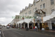 seafront-amusements-buldings-in-rhyl-on-an-overcast-wet-summers-day-august-2015-north-wales-uk
