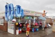 seaside-souvenir-gift-shop-on-cold-rainy-overcast-british-summer-north-wales-uk
