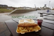 deep-fried-cheap-fish-chips-on-wet-summers-day-at-seaside-resort-in-north-wales-uk